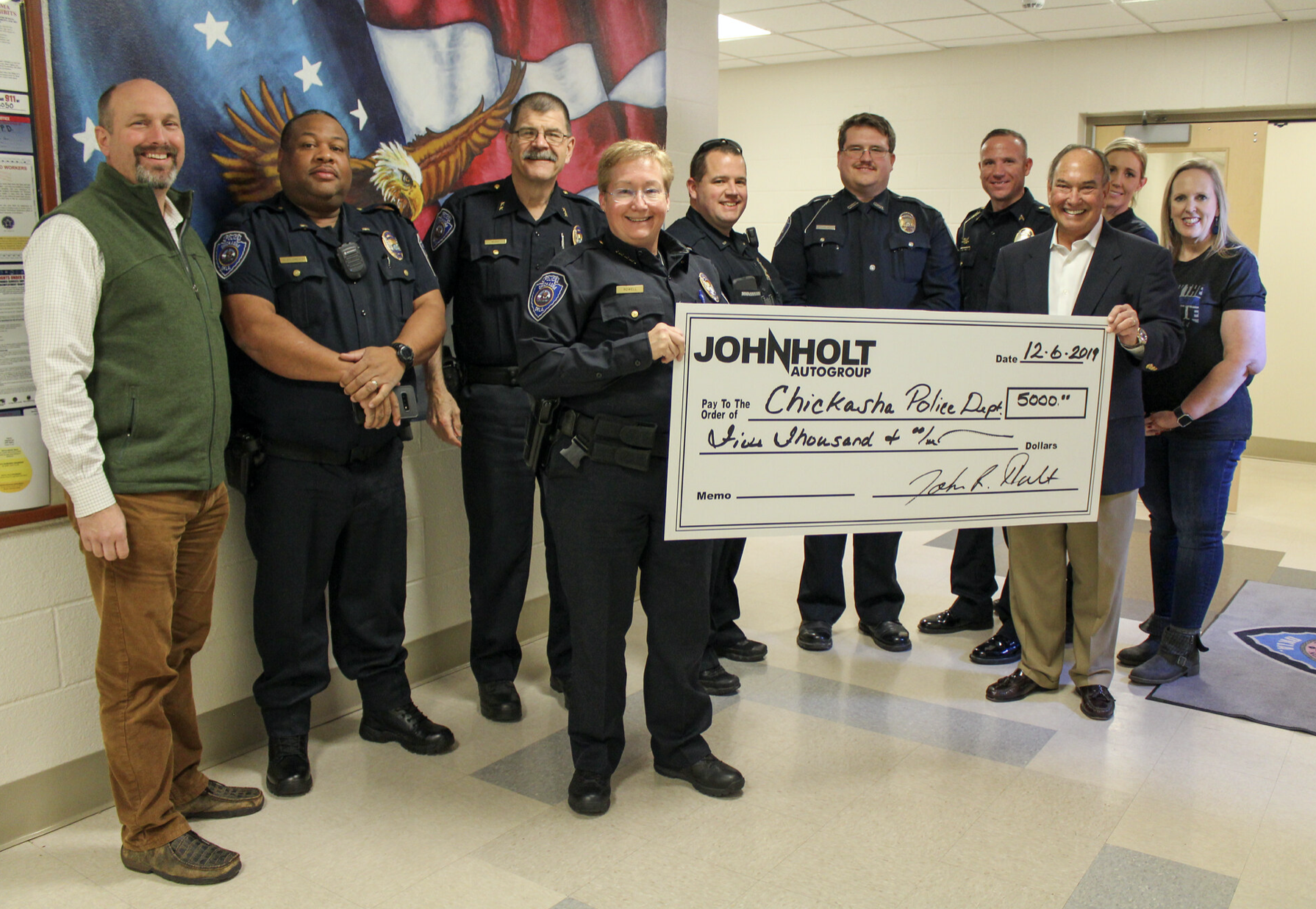 John Holt Check Presentation - PD